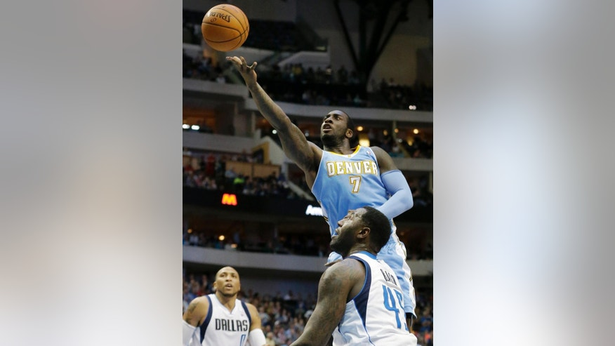 Denver Nuggets center J.J. Hickson (7) shoots against Dallas Mavericks center DeJuan Blair (45) as Shawn Marion (0) looks on during the first half an NBA basketball game Friday, March 21, 2014, in Dallas. (AP Photo/LM Otero)