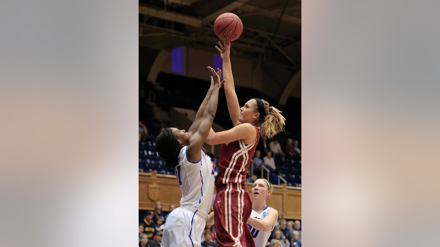 Oklahoma's Nicole Kornet shoots over  DePaul's Jasmine Penny during the first half of their first-round game in the NCAA basketball tournament in Durham, N.C., Saturday, March 22, 2014. (AP Photo/Ted Richardson)