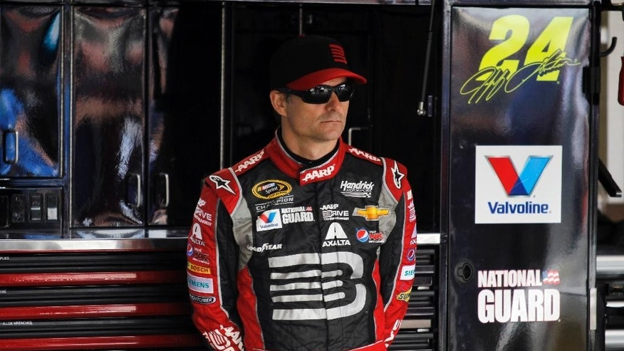 Driver Jeff Gordon (24) waits in his garage to practice for the NASCAR Sprint Cup series auto race in Fontana, Calif., Saturday, March 22, 2014.(AP Photo/Alex Gallardo)