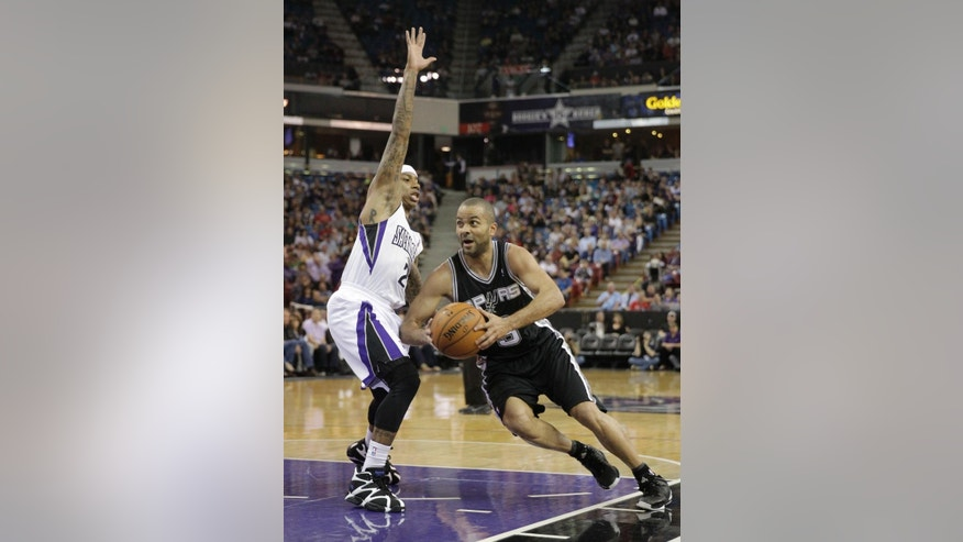 San Antonio Spurs guard Tony Parker, right, of France, drives to basket against Sacramento Kings guard Isaiah Thomas during the first quarter of an NBA basketball game in Sacramento, Calif., Friday, March 21, 2014.(AP Photo/Rich Pedroncelli)