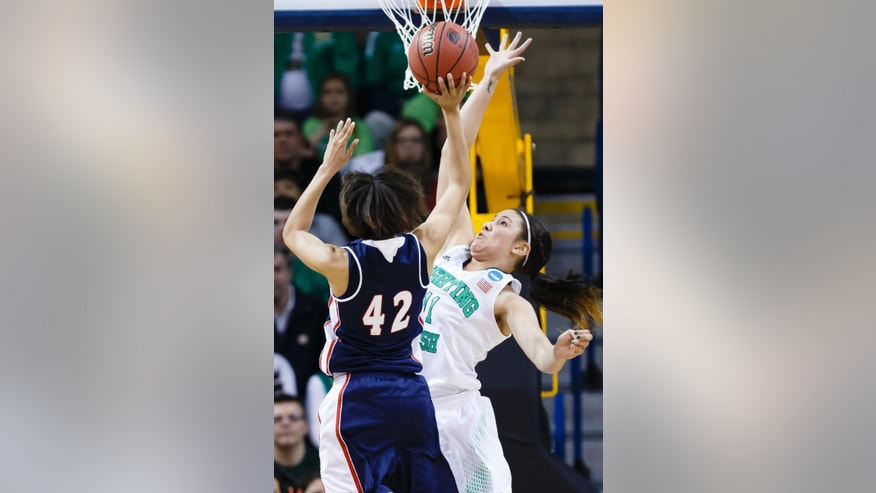 Robert Morris forward Kelly Hartwell (42) shoots over Notre Dame forward Natalie Achonwa (11) during the first half in a first-round game in the NCAA women's college basketball tournament, Saturday, March 22, 2014, in Toledo, Ohio. (AP Photo/Rick Osentoski)