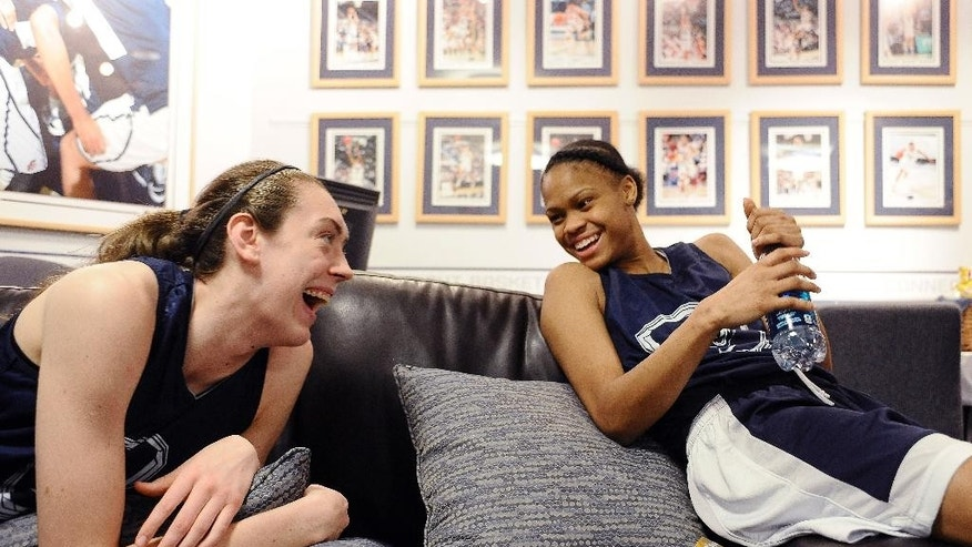 Connecticut's Breanna Stewart, left, and Moriah Jefferson share a light moment in their locker room before practice for a first-round game in the NCAA women's college basketball tournament, Saturday, March 22, 2014, in Storrs, Conn. Connecticut practices in advance of Sunday's game against Prairie View A&M. (AP Photo/Jessica Hill)