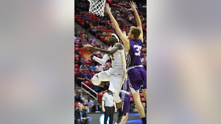 Virginia Commonwealth guard Briante Weber, left, shoots under Stephen F. Austin forward Tanner Clayton, right, during the first half of a second-round game in the NCAA college basketball tournament Friday, March 21, 2014, in San Diego. (AP Photo/Denis Poroy)