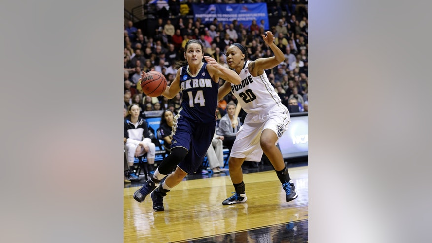 Akron guard Hanna Luburgh, left, drives on Purdue guard Dee Dee Williams during the first half of a first-round game in the NCAA women's college basketball tournament, Saturday, March 22, 2014, in West Lafayette, Ind. (AP Photo/Michael Conroy)