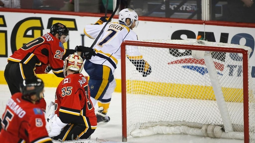 Nashville Predators' Matt Cullen, right, celebrates his goal as Calgary Flames goalie Joey Macdonald, center, and Flames' Curtis Glencross, left rear, watch during the third period of an NHL hockey game in Calgary, Alberta, Friday, March 21, 2014. The Predators won 6-5. (AP Photo/The Canadian Press, Jeff McIntosh)