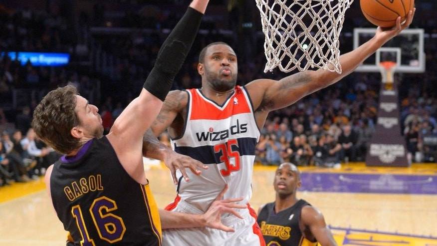 Washington Wizards forward Trevor Booker, right, puts up a shot as Los Angeles Lakers center Pau Gasol, of Spain, defends during the first half of an NBA basketball game, Friday, March 21, 2014, in Los Angeles. (AP Photo/Mark J. Terrill)