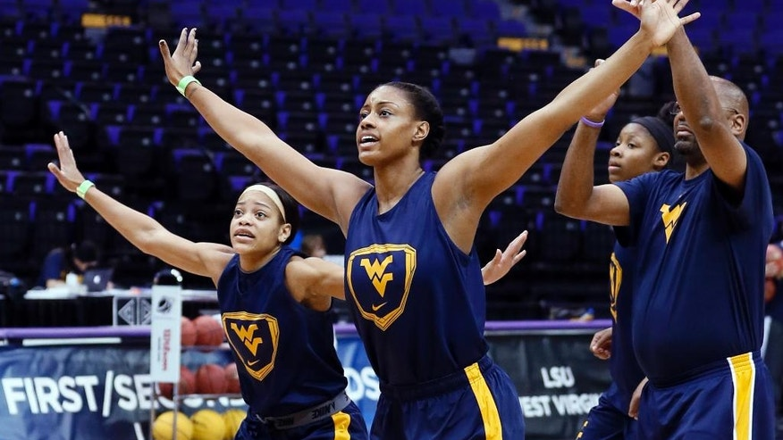 West Virginia guard Christal Caldwell, left, and center Asya Bussie take defensive positions during practice at the NCAA women's college basketball tournament in Baton Rouge, La., Saturday, March 22, 2014. West Virginia faces Albany in a first-round game on Sunday. (AP Photo/Rogelio V. Solis)