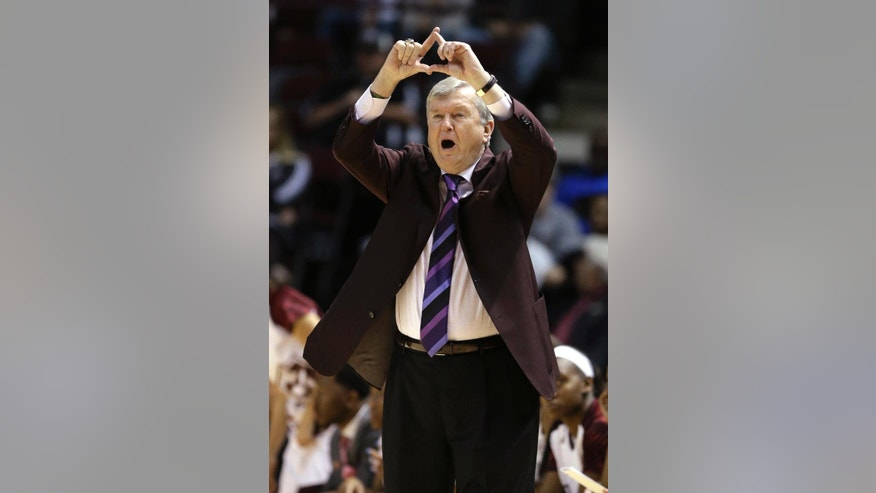 Texas A&M coach Gary Blair signals his players in the first half of a first-round NCAA women's basketball game against North Dakota Sunday, March 23, 2014, in College Station, Texas. The winner will face James Madison in the second round Tuesday night. (AP Photo/Pat Sullivan)