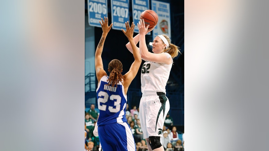 Michigan State's Becca Mills (52) shoots over Hampton's Tyler Hobgood during the first half of a first-round game of the NCAA college basketball tournament in Chapel Hill, N.C., Sunday, March 23, 2014. (AP Photo/Ellen Ozier)