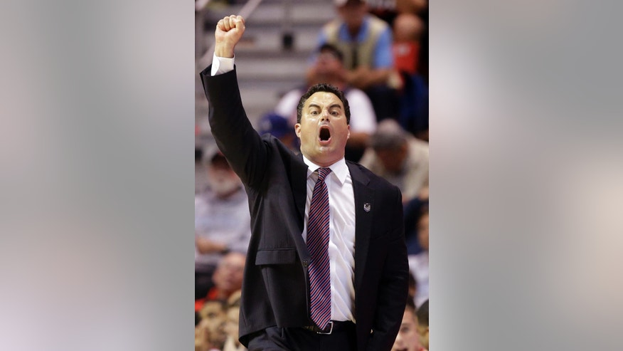 Arizona head coach Sean Miller gestures to his team as they play Gonzaga during the first half of a third-round game in the NCAA college basketball tournament Sunday, March 23, 2014, in San Diego. (AP Photo/Lenny Ignelzi)