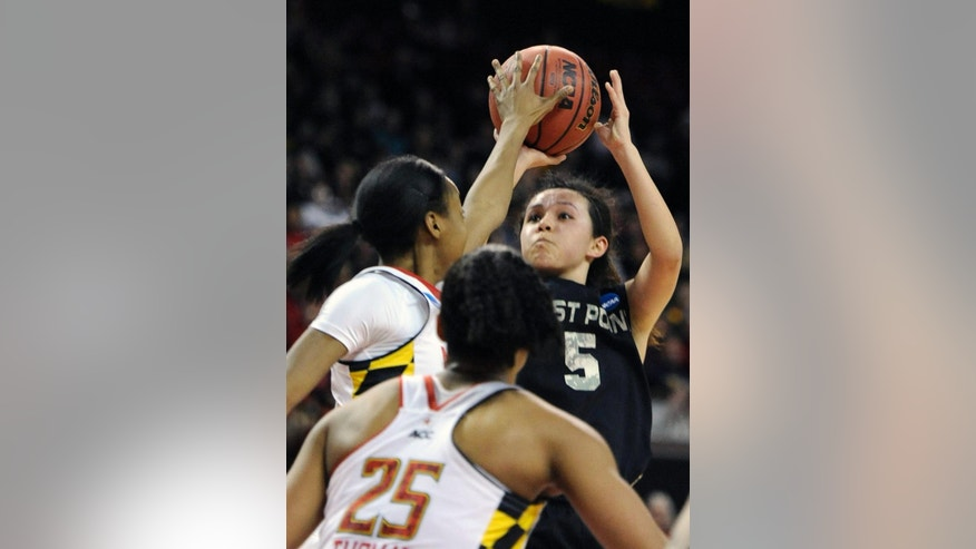 Army's Kelsey Minato (5) shoots over Maryland's Shatori Walker-KImbrough during the first half of the first round of the NCAA women's college basketball tournament on Sunday, March 23, 2014, in College Park, Md. Maryland won 90-52. (AP Photo/Gail Burton)