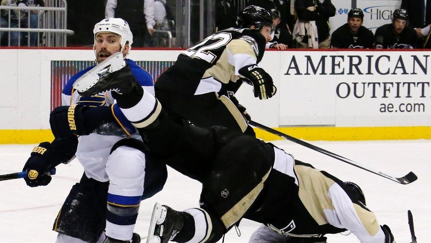 St. Louis Blues' Barret Jackman (5) collides with Pittsburgh Penguins' Sidney Crosby, right, in the second period of an NHL hockey game in Pittsburgh, Sunday, March 23, 2014. (AP Photo/Gene J. Puskar)