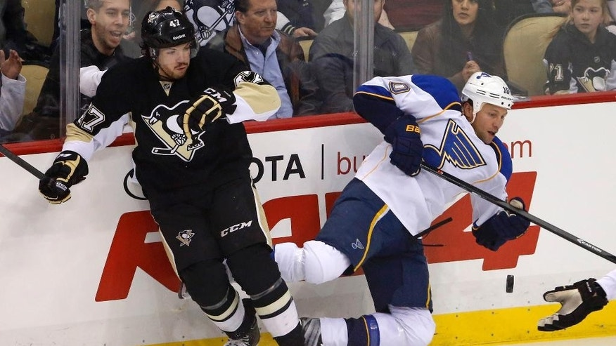 Pittsburgh Penguins' Simon Despres (47) collides with St. Louis Blues' Brenden Morrow (10) in the first period of an NHL hockey game in Pittsburgh, Sunday, March 23, 2014. (AP Photo/Gene J. Puskar)