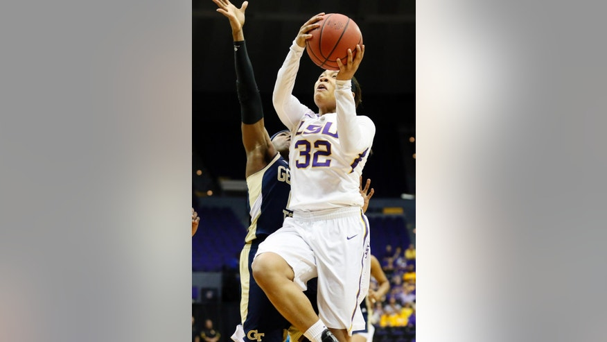 LSU guard Danielle Ballard (32) attempts a layup past a Georgia Tech defender in the first half of an NCAA college basketball first-round tournament game on Sunday, March 23, 2014, in Baton Rouge, La. (AP Photo/Rogelio V. Solis)