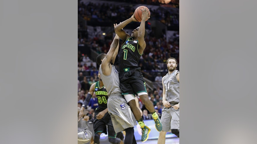 Baylor's Kenny Chery (1) shoots over Creighton's Jahenns Manigat, left, during the first half of a third-round game in the NCAA college basketball tournament Sunday, March 23, 2014, in San Antonio. (AP Photo/Eric Gay)