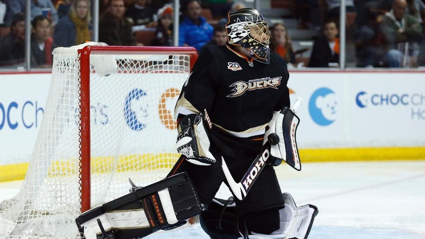 Anaheim Ducks goalie Jonas Hiller makes a save against the Florida Panthers during the first period of an NHL hockey game, Sunday, March 23, 2014, in Anaheim, Calif. (AP Photo/Danny Moloshok)