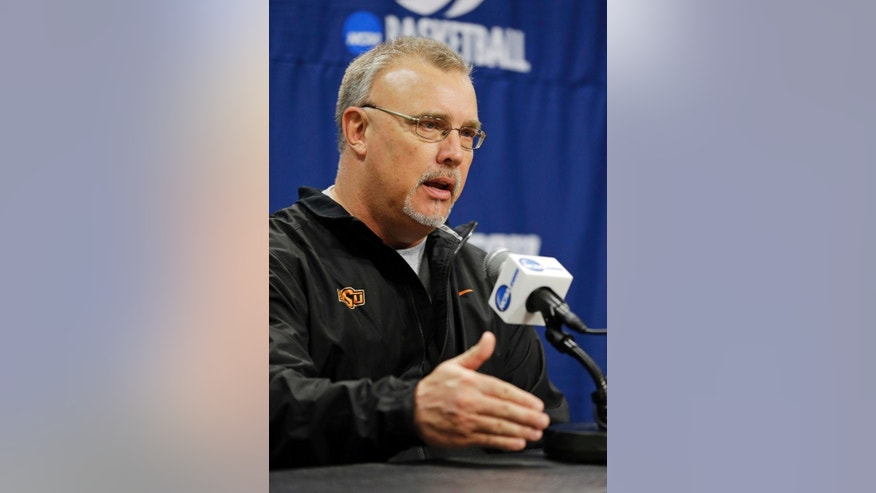 Oklahoma State head coach Jim Littell answers a question during an NCAA college basketball tournament news conference in West Lafayette, Ind., Sunday, March 23, 2014. Oklahoma State faces Purdue in a second round game on Monday. (AP Photo/Michael Conroy)