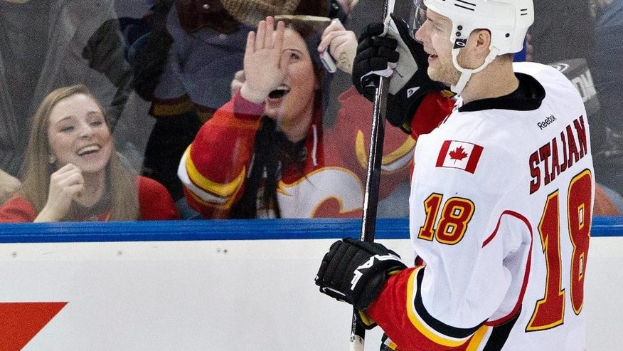 Calgary Flames' Matt Stajan (18) celebrates a goal against the Edmonton Oilers during the second period of an NHL hockey game Saturday, March 22, 2014, in Edmonton, Alberta. (AP Photo/The Canadian Press, Jason Franson)