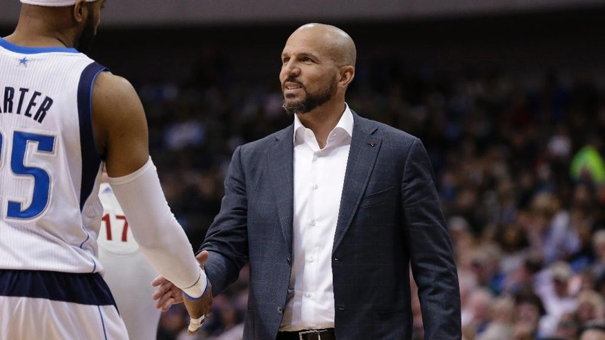 Brooklyn Nets head coach Jason Kidd, right, shakes hands with Dallas Mavericks guard Vince Carter (25) during the first half of an NBA basketball game Sunday, March 23, 2014, in Dallas. (AP Photo/LM Otero)