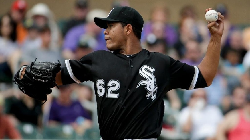 Chicago White Sox starting pitcher Jose Quintana throws against the Colorado Rockies during the third inning of a spring exhibition baseball game in Scottsdale, Ariz., Sunday, March 23, 2014. (AP Photo/Chris Carlson)