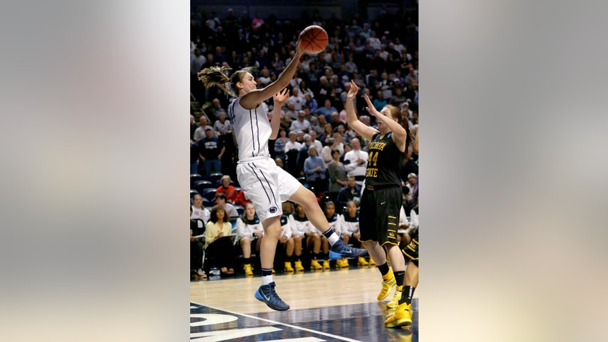 Penn State's Tori Waldner, left, saves the ball in front of Wichita State's Michaela Dapprich during the first half in a first-round game in the NCAA college basketball tournament on Sunday, March 23, 2014, in State College, Pa. (AP Photo/Keith Srakocic)