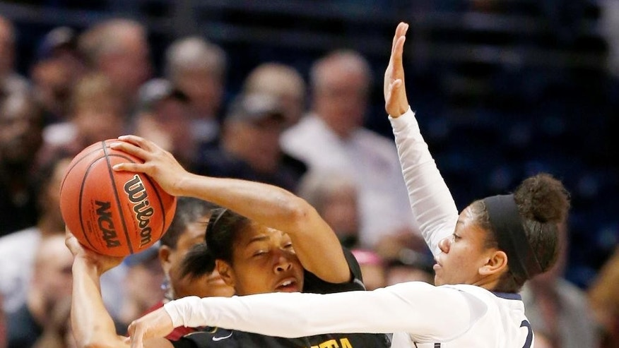 Penn State's Dara Taylor (2) defends against Wichita State's Alex Harden (24) during the first half in a first-round game in the NCAA college basketball tournament on Sunday, March 23, 2014, in State College, Pa. (AP Photo/Keith Srakocic)