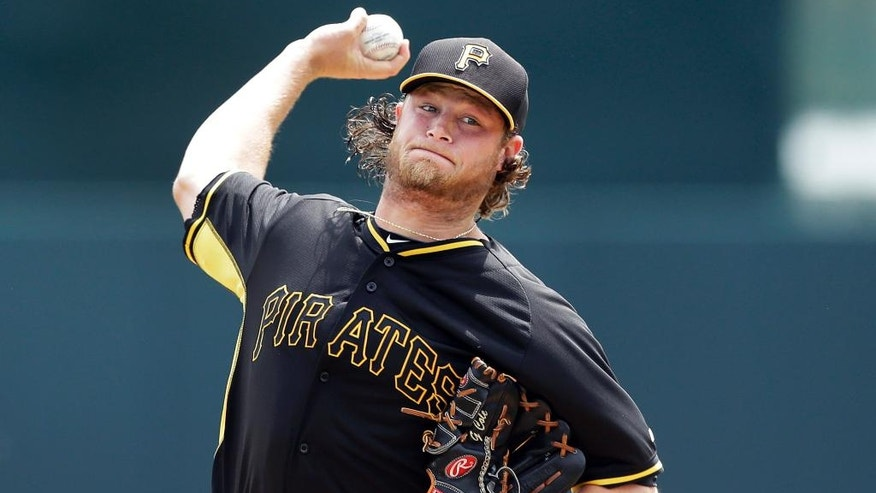 Pittsburgh Pirates starting pitcher Gerrit Cole throws during the first inning of a spring exhibition baseball game against the Baltimore Orioles in Sarasota, Fla., Sunday, March 23, 2014. (AP Photo/Carlos Osorio)