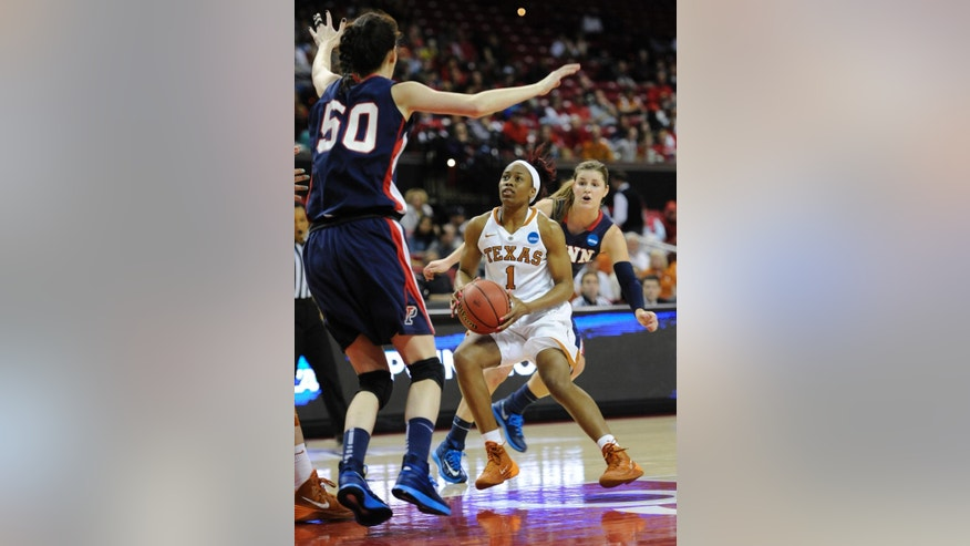 Texas' Empress Davenport (1) drives to the basket as Penn's Courtney Wilson, left, and Alyssa Baron defend during the first half of the first round of the NCAA women's college basketball tournament on Sunday, March 23, 2014, in College Park, Md. (AP Photo/Gail Burton)