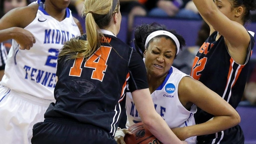 Oregon State's Ali Gibson (14) and Middle Tennessee State's Lauren March, right, battle for a held ball in the first half of a first-round game in the NCAA women's college basketball tournament, Sunday, March 23, 2014, in Seattle. (AP Photo/Ted S. Warren)