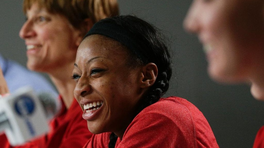 Nebraska's Tear'a Laudermill, center, smiles as she is joined by head coach Connie Yori, background left, and teammate Emily Cady during a news conference on Sunday, March 23, 2014, in Los Angeles. Nebraska is scheduled to play BYU in a second-round game of the NCAA women's college basketball tournament on Monday. (AP Photo/Jae C. Hong)