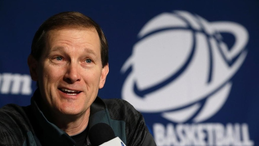 Oregon head coach Dana Altman speaks during a news conference for the third-round game of the NCAA college basketball tournament Friday, March 21, 2014, in Milwaukee. Oregon plays Wisconsin on Saturday. (AP Photo/Morry Gash)