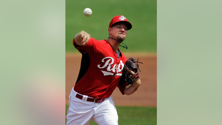 Cincinnati Reds starting pitcher Mike Leake delivers against the Milwaukee Brewers in the first inning of a spring exhibition baseball game Sunday, March 23, 2014, in Goodyear, Ariz. (AP Photo/Mark Duncan)