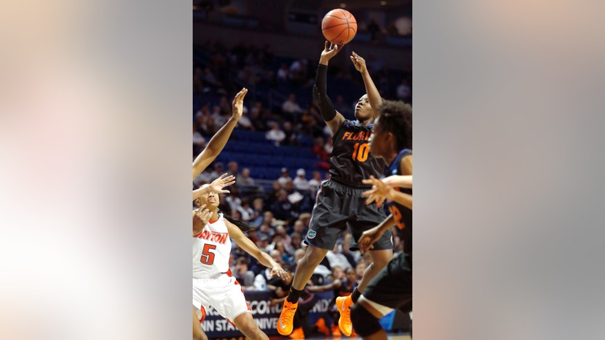 Florida's Jaterra Bonds (10) shoots over Dayton's Celeste Edwards (5) during the first half of a first-round game in the NCAA college basketball tournament on Sunday, March 23, 2014, in State College, Pa. (AP Photo/Keith Srakocic)