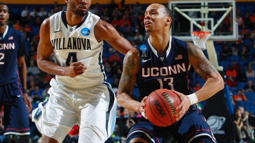 Villanova's Darrun Hilliard II (4) defends Connecticut's Shabazz Napier (13) during the second half of a third-round game in the NCAA men's college basketball tournament in Buffalo, N.Y., Saturday, March 22, 2014. (AP Photo/Bill Wippert)