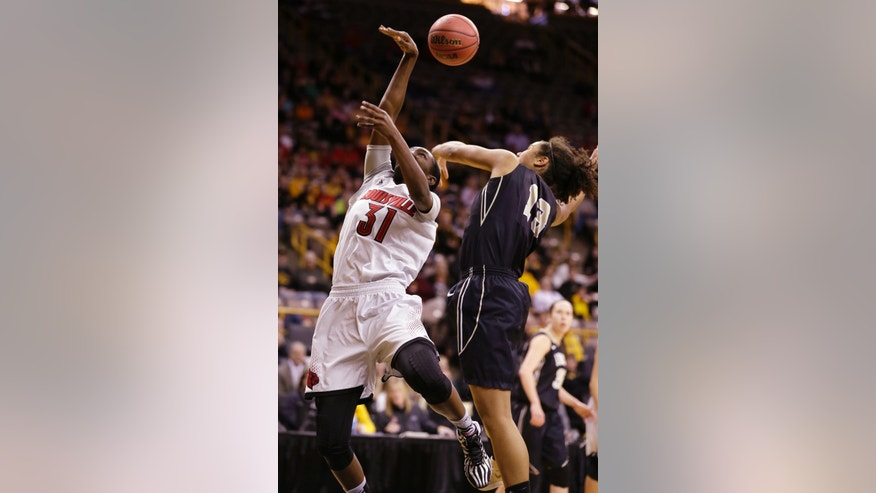 Louisville forward Asia Taylor, left, is fouled by Idaho forward Ali Forde while driving to the basket during the first half of an NCAA tournament first-round women's college basketball game, Sunday, March 23, 2014, in Iowa City, Iowa. (AP Photo/Charlie Neibergall)