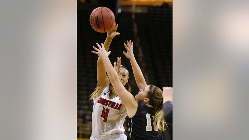 Louisville guard Antonita Slaughter, left, passes over Idaho guard Stacey Barr during the first half of an NCAA tournament first-round women's college basketball game, Sunday, March 23, 2014, in Iowa City, Iowa. (AP Photo/Charlie Neibergall)