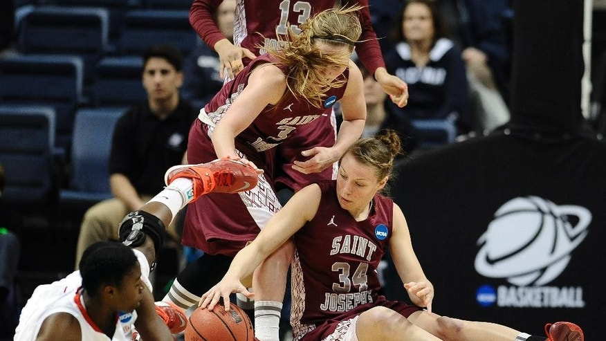 Saint Joseph's Erin Shields, center, and Kelsey Berger, right, fight with with Georgia's Krista Donald, left, for possession of the ball during the first half of a first-round game of the NCAA women's college basketball tournament, Sunday, March 23, 2014, in Storrs, Conn. (AP Photo/Jessica Hill)