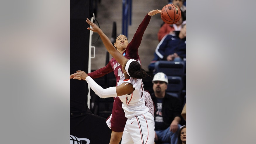 Saint Joseph's Natasha Cloud, left, blocks the shot of Georgia's Shacobia Barbee, right, during the first half of a first-round game of the NCAA women's college basketball tournament, Sunday, March 23, 2014, in Storrs, Conn. (AP Photo/Jessica Hill)