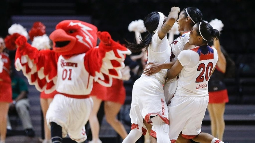 St. John's guard Briana Brown, center, celebrates with Aliyyah Handford, left, and Keylantra Langley (20) after Brown hit a 3-point shot to give St. John's a 71-68 win over Southern California in an NCAA women's college basketball first-round tournament game Saturday, March 22, 2014, in Knoxville, Tenn. (AP Photo/Mark Humphrey)
