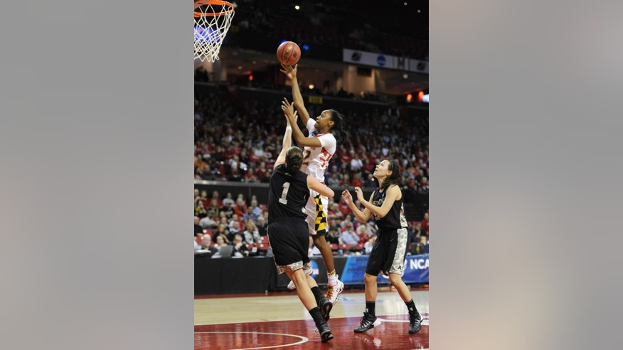 Maryland's Shatori Walker- Kimbrough, top, shoots as Army's Jen Hazlett (1) and Kelsey Minato defend during the first half of the first round of the NCAA women's college basketball tournament, Sunday, March 23, 2014, in College Park, Md.(AP Photo/Gail Burton)