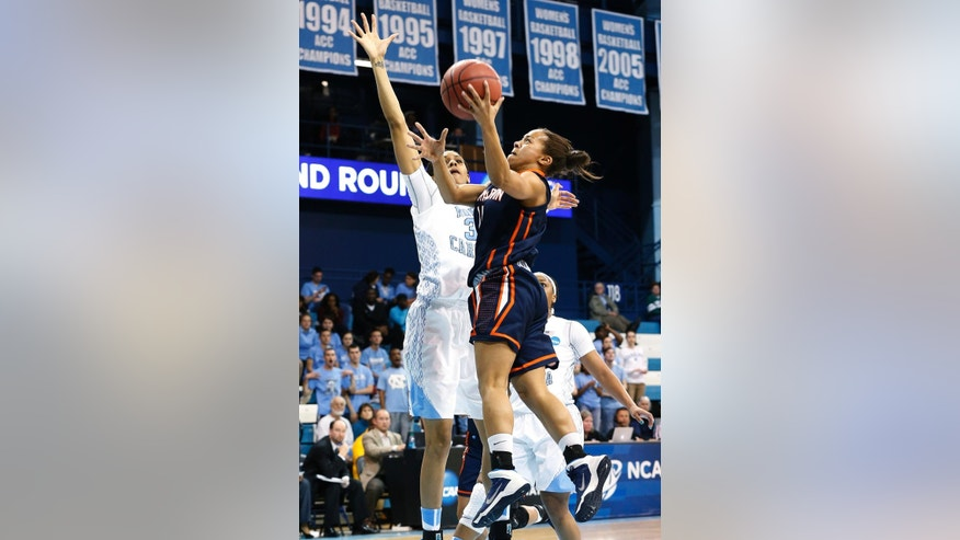UT-Martin's Heather Butler, right, goes to the basket against North Carolina's Hillary Summers during the first half of a first-round game of the NCAA women's college basketball tournament, Sunday, March 23, 2014, in Chapel Hill, N.C. (AP Photo/Ellen Ozier)
