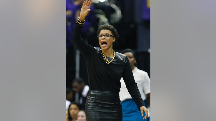 LSU basketball coach Nikki Caldwell signals her team in the second half of an NCAA college basketball first-round tournament game against Georgia Tech, Sunday, March 23, 2014, in Baton Rouge, La. LSU won 98-78. (AP Photo/Rogelio V. Solis)