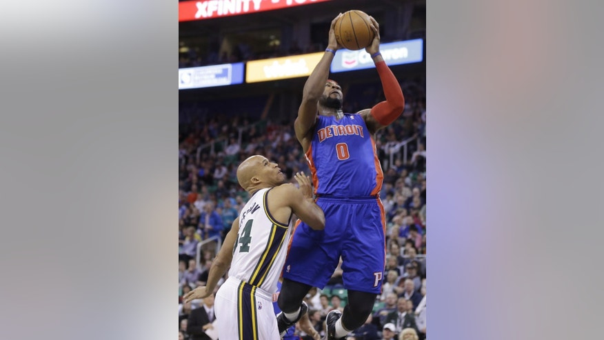 Detroit Pistons' Andre Drummond (0) goes to the basket as Utah Jazz's Richard Jefferson, left, looks on in the second quarter during an NBA basketball game Monday, March 24, 2014, in Salt Lake City. (AP Photo/Rick Bowmer)