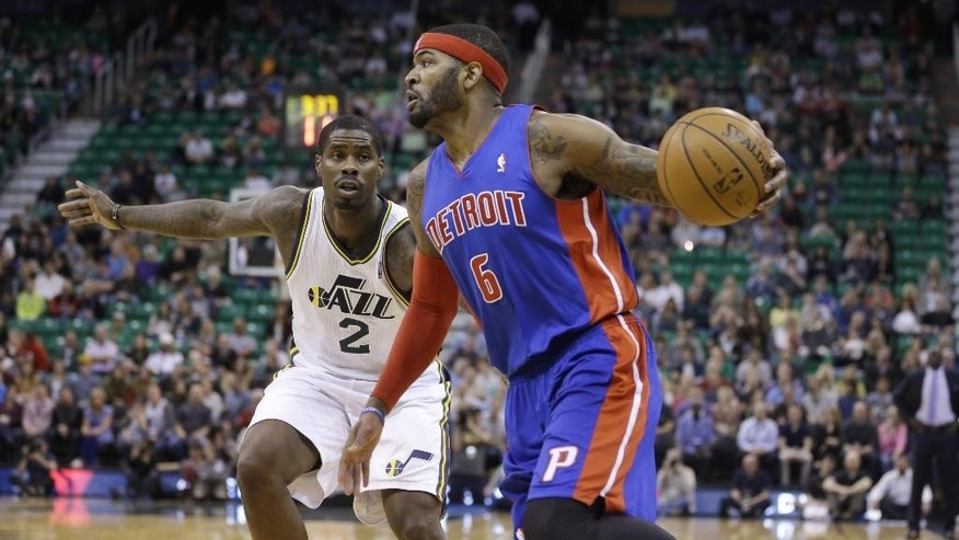 Detroit Pistons' Josh Smith (6) drives to the basket as Utah Jazz's Marvin Williams (2) defends in the first quarter during an NBA basketball game Monday, March 24, 2014, in Salt Lake City. (AP Photo/Rick Bowmer)