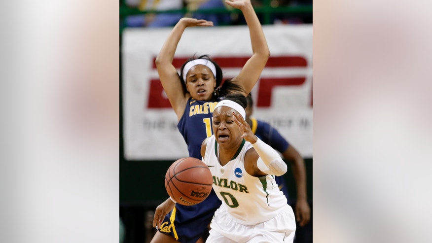 Baylor's Odyssey Sims (0) loses control of the ball as after colliding with California's  Brittany Boyd, rear, in the first half of a second-round game in the NCAA women's college basketball tournament, Monday, March 24, 2014, in Waco, Texas. (AP Photo/Tony Gutierrez)