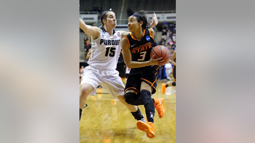 Oklahoma State guard Tiffany Bias, right, drives on Purdue guard Courtney Moses during the first half of a women's second round NCAA tournament college basketball game in West Lafayette, Ind., Monday, March 24, 2014.  (AP Photo/Michael Conroy)