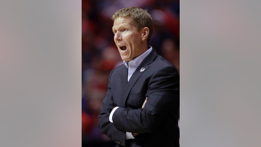 Gonzaga head coach Mark Few yells from the bench as the team plays Arizona during the first half of a third-round game in the NCAA college basketball tournament Sunday, March 23, 2014, in San Diego. (AP Photo/Lenny Ignelzi)