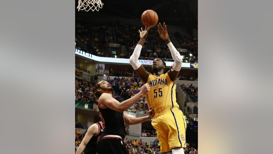 Indiana Pacers center Roy Hibbert (55) shoots as Chicago Bulls center Joakim Noah defends during the second half of an NBA basketball game in Indianapolis, Friday, March 21, 2014. The Pacers won 91-79. (AP Photo/R Brent Smith)