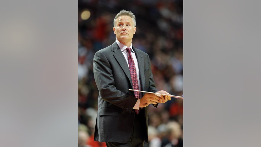 Philadelphia 76ers coach Brett Brown looks up at the scoreboard during the second half of an NBA basketball game against the Chicago Bulls in Chicago on Saturday, March 22, 2014. The Bulls won 91-81. (AP Photo/Nam Y. Huh)