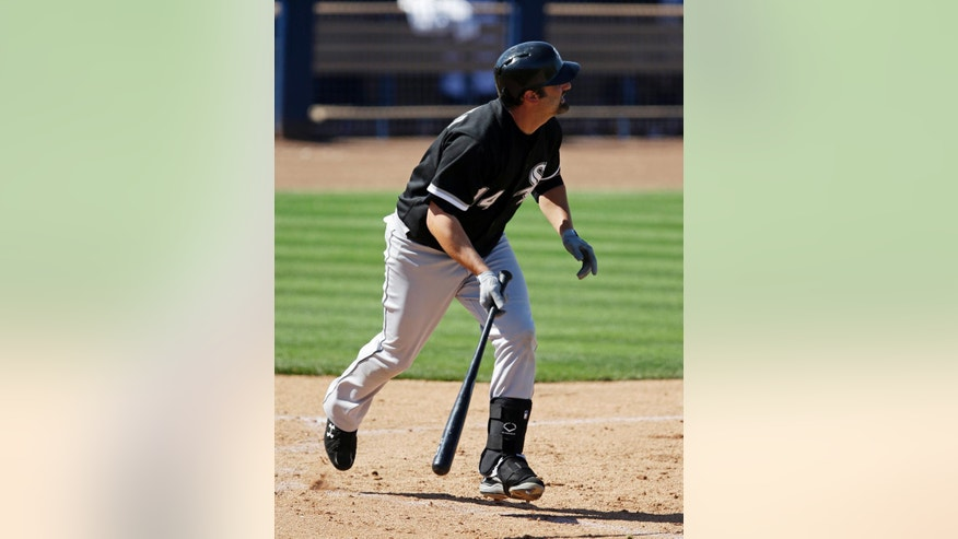 Chicago White Sox's Paul Konerko watches his two-run home run during the sixth inning of a spring exhibition baseball game against the Seattle Mariners, Monday, March 24, 2014, in Peoria, Ariz. (AP Photo/Darron Cummings)